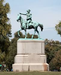 This image has an empty alt attribute; its file name is statue-in-park.jpg
